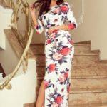 Dlouhé dámské MAXI sportovní šaty s rozparkem a velkými červenými květy model 7268090